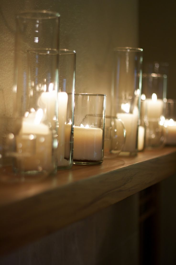 Pillar candles in cylinder vases and varied sizes of mercury glass candles will be placed on the mantle