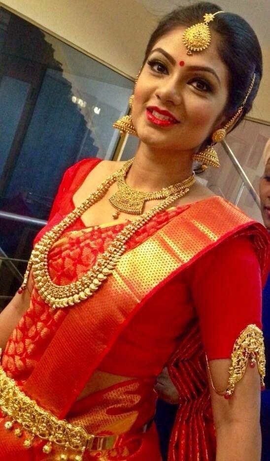 South Indian bride. Gold Indian bridal jewelry.Temple jewelry. Jhumkis. Classic Red silk kanchipuram sari.Braid with fresh flowers. Tamil bride. Telugu bride. Kannada bride. Hindu bride. Malayalee bride.Kerala bride.South Indian wedding.
