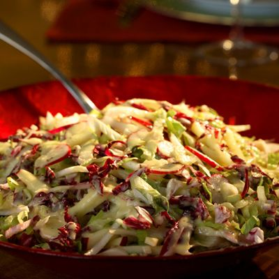Red and White Salad is a mix of romaine, endive, fennel, hearts of palm, radicchio, apple, and radishes, topped with Champagne Vinaigrette. Get the recipe at Delish.com