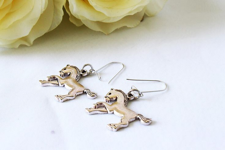 Do you like this horse earring? You can find it here: https://www.etsy.com/listing/570011556/horse-jewelry-horse-earrings-kids?ref=related-2