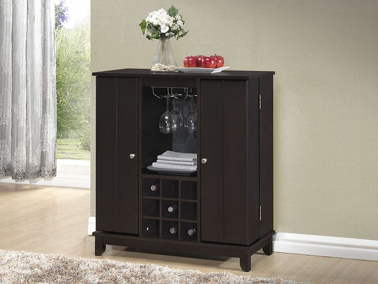 This spectacular wenge stained Derremer wine cabinet features widely-opening doors that open to bottle storage, glass ware storage, hanging wine glass racks, and more.