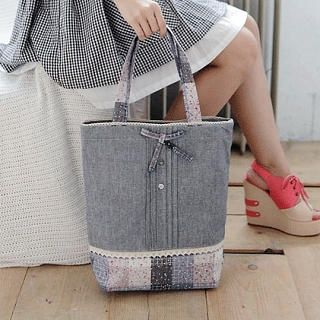 Good use for short pieces of jelly rolls along the bottom of tote-looks like lace trim and maybe pintucks