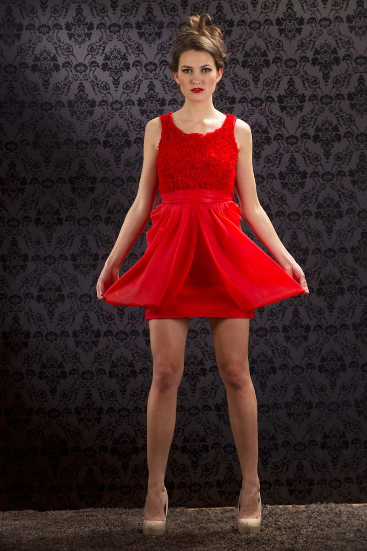 This sizzling hot short red chiffon dress has a tulip-style skirt and rosette embelished bodice.  The matching chiffon belt ties into a big bow in the back.  www.pinktiger.com.
