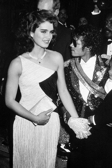 Brooke Shields & Michael Jackson - Brooke always hated holding the hand with the glove because it hurt her lol