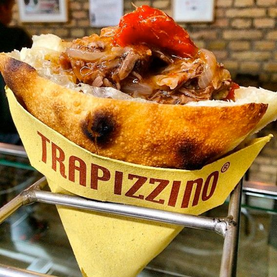 """The """"trapizzino"""" is a triangle of white pizza cut in the middle and stuffed with a few tablespoons of coda alla vaccinara(oxtail cooked with tomatoes). It's strange, but delicious."""