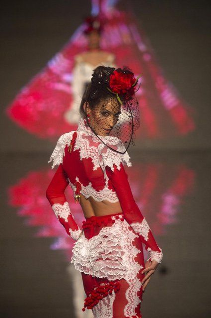 A model wears a creation by Spanish designer Rosalia Zahino during the International Flamenco Fashion Show in Seville, Spain on Saturday, February 2, 2013. (Photo by Miguel Angel Morenatti/AP Photo) a través de Avax Newz http://avaxnews.net/fact/International_Flamenco_Fashion_Show_in_Seville.html #avaxnews.net #Fashion #wear