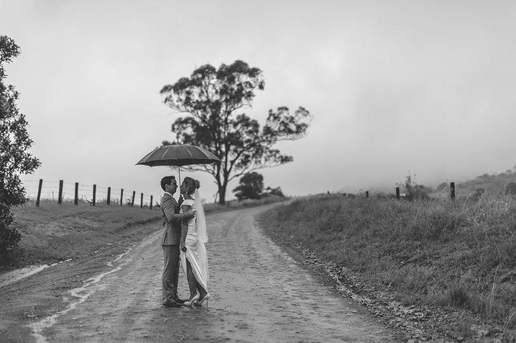 Wet weather wedding photo. Hunter Valley wedding. Image: Cavanagh Photography http://cavanaghphotography.com.au