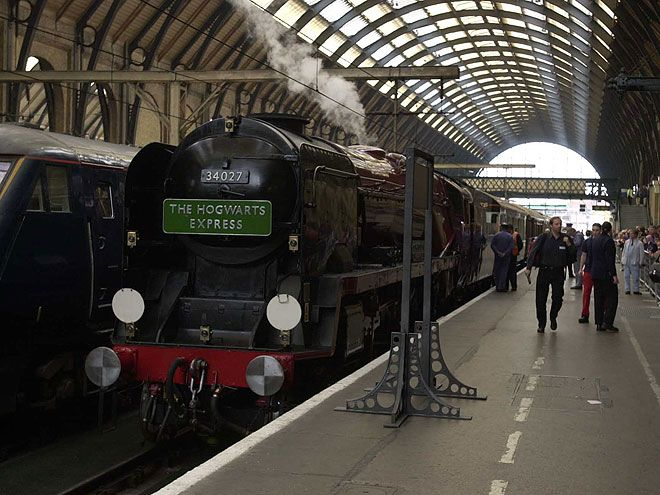 "11 Real-Life Harry Potter Destinations You Can Visit | KING'S CROSS STATION, LONDON | Perhaps one of the best known Harry Potter attractions, this iconic train station has a Platform 9 3/4 sign, complete with a cart appearing to be halfway through the wall. The ""platform"" may be a fake, but Potter still travels through the real King's Cross in the film, so it's doubly worth a trip."