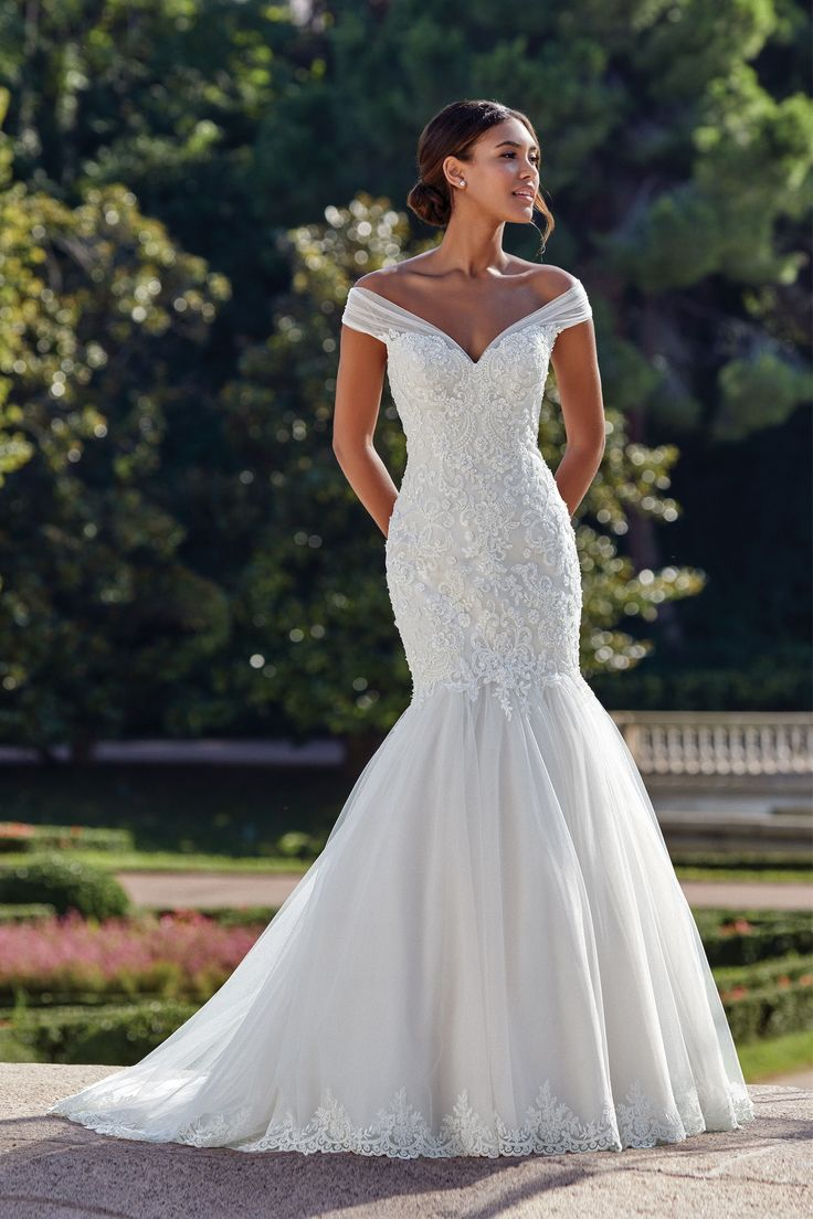 Sincerity #44148 – Fit and flare wedding gown. Beaded lace bodice with a tulle f…
