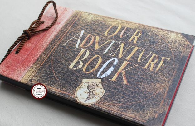 """An """"Our Adventure Book"""" scrapbook that looks like the one Carl and Ellie made in Up."""
