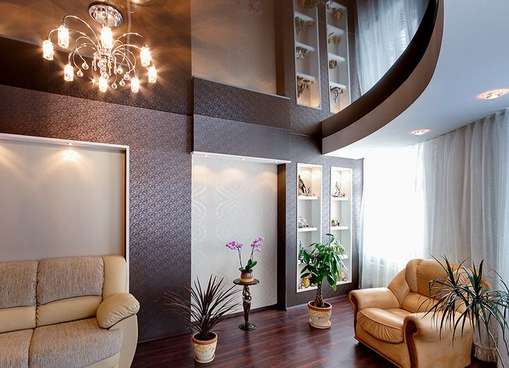 Multilevel stretch ceiling in a living room.