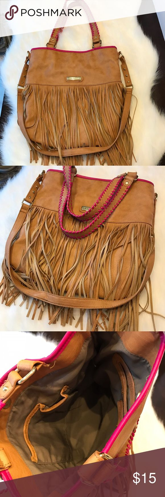 Steve Madden like new purse fringe handbag 👜 Perfect condition, only used once. Steve Madden purse, clean inside and out like new. Tan with pink piping. Really cool purse. Can be used as a shoulder bag or as or crossover Steve Madden Bags Shoulder Bags