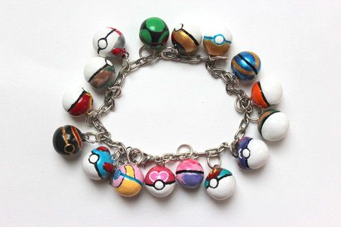 A charm bracelet with 16 different types of pokeballs!  Comes with: heal, great, luxury, repeat, safari, timer, dusk, level, park, quick, sports, nest, master, lure, heal, dream, and love.   Handmade with polymer clay.  Each ball is handpainted to the last detail and finished with a shiny gl..
