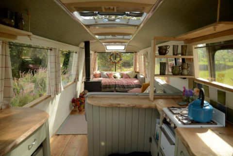 """Now, the bus features a wooden floor, painted pine paneling, and a fully-fledged kitchen space that includes a gas cooker and a refrigerator. """"We are really into green living and trying to be as low-impact and as self-sufficient as we can be,"""" says Layla, in a promotional video. """"I think it's nice for people to come here and see how it works and stay somewhere that doesn't have limitless power."""""""