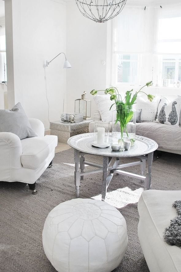 living room poufs%0A all white moroccan inspired space