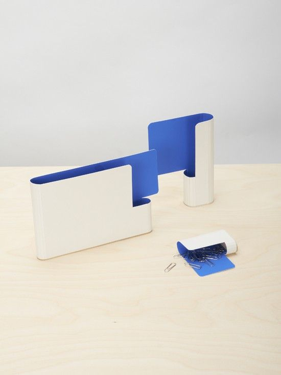 inspired by the movements of a crumb collector, made out of rolled metal, the desk set Arrotolare collects everything that rests upon the des...