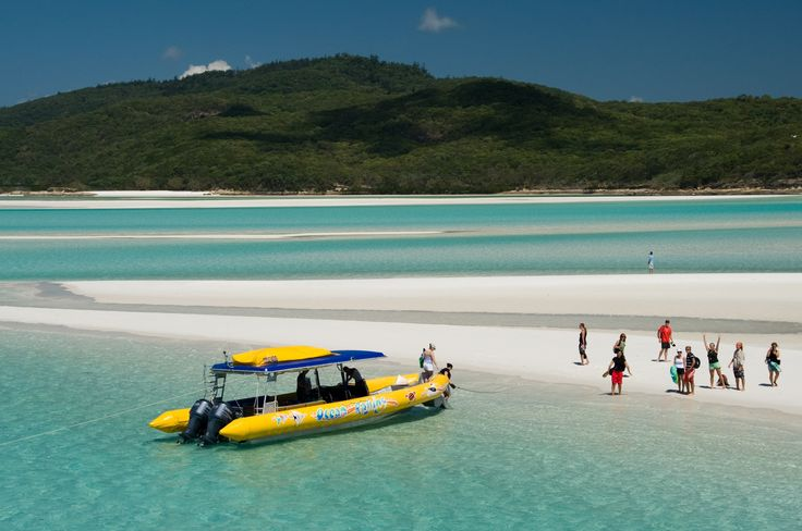"Whitsundays Whitehaven Beach - A definite ""must-see"". The crystal clear aqua waters and pristine silica sand of Whitehaven stretch over seven kilometres along Whitsunday Island, the largest of the 74 islands in the Whitsundays. Getting there: Ocean Rafting."