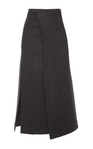 This **Marni** skirt is rendered in wool herringbone felt and features a high waist with a wraparound design at the front, a knee length a-line silhouette and an exaggerated split at the side.