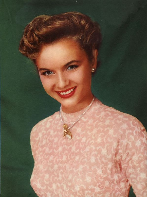 Debbie Reynolds. Maybe by first creating a rat on the top, leaving out a thin front section, then using that section to cover the ratting with a nice wave.
