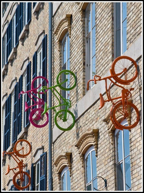 I like the full color of these bikes in contrast to the city scene. This could be interesting done as a vector.