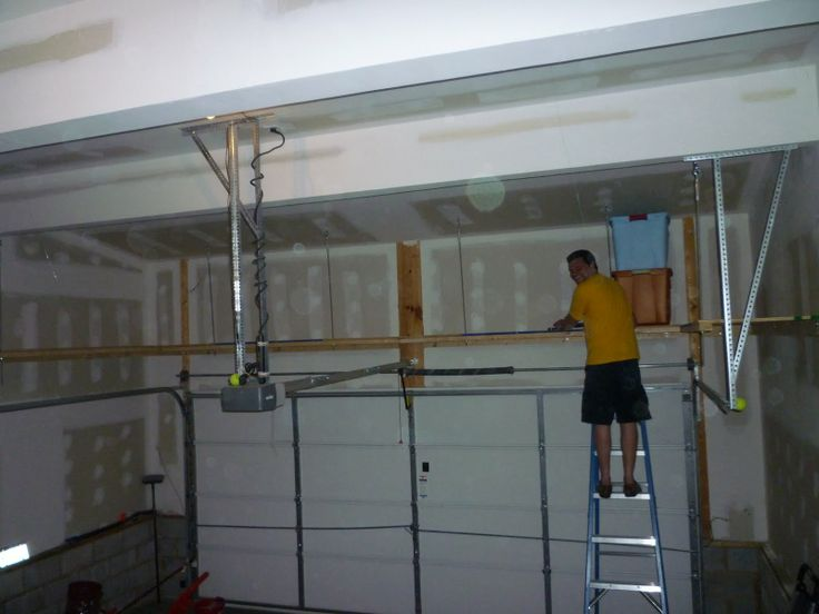 We Needed Some Extra Storage Space, So Scott Built These Shelves In The Garage  Above The Garage Door.