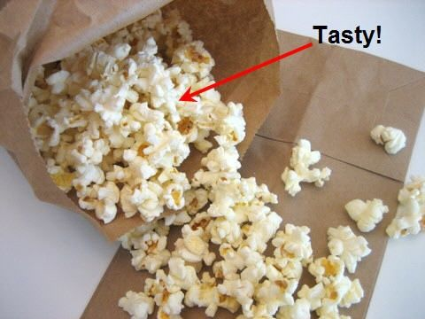 Add a 1/2 cup scoop of bulk popcorn kernels to your brown paper bag. Fold the bag over twice. Don't use staples to secure the bag - this might spark in your microwave. Set for 3 minutes. Mexican: Add chili powder, hot sauce, and salt. Kiss My Breath: Shake in onion powder and garlic powder - hold the kiss. Cheese Please: Mix in Parmesan cheese with a little salt. Sweet Tooth: A dash of cinnamon, a sprinkle of sugar, and a topper of honey. Now that's money. Classic: A shake of -