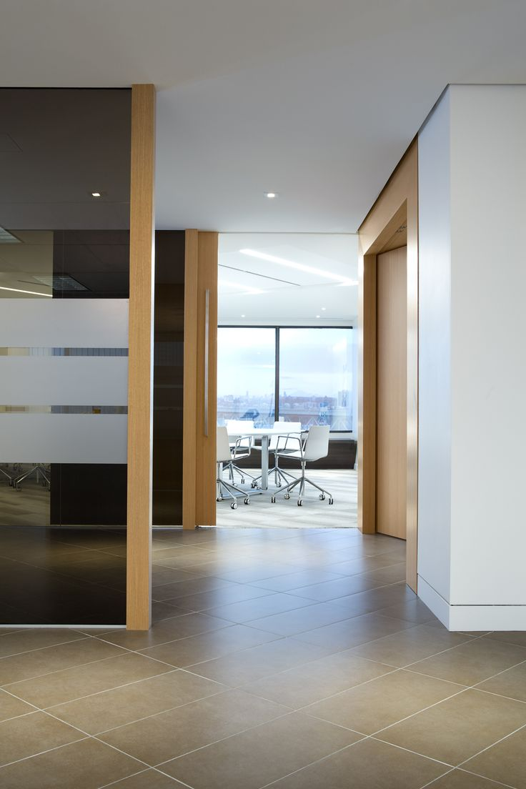 SSDG Interiors Inc.   workplace executive office: Financial Institution. Bright and modern interior design of an office in Vancouver with wood and glass walls, and grey tile.