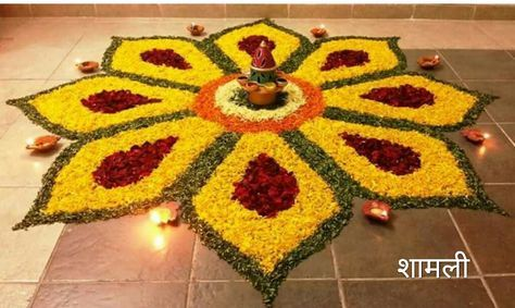 Latest creative flower rangoli for festival or special occasion decorated using diya