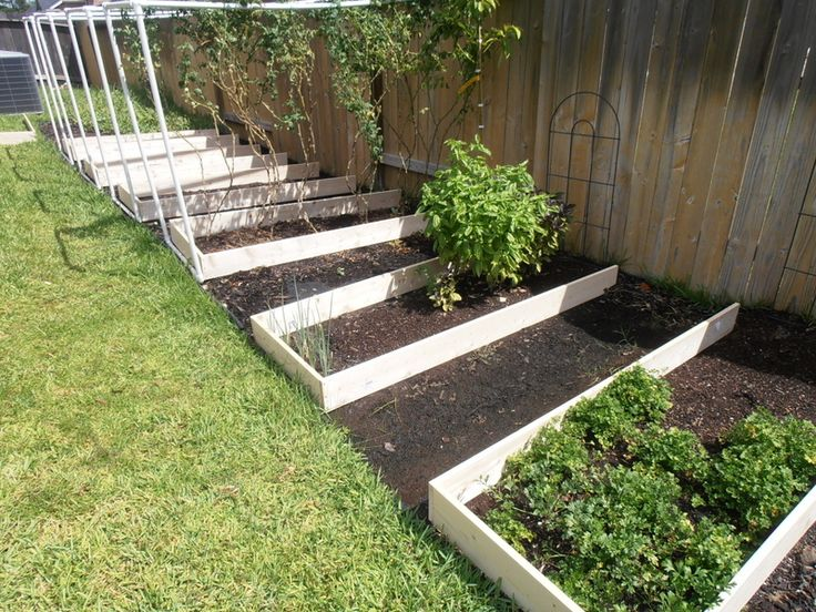Fall gardening season is here! Constructed 8 raised bed frames over the weekend using untreated wood and some nails. Left the end by the fence open to maintain lawn grading and facilitate proper drainage.