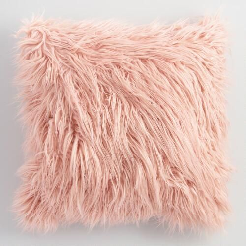 Elevate your space with boutique store style without the price tag. Our generously sized throw pillow mimics the sumptuously soft look and feel of Mongolian lamb's wool in a chic blush hue.