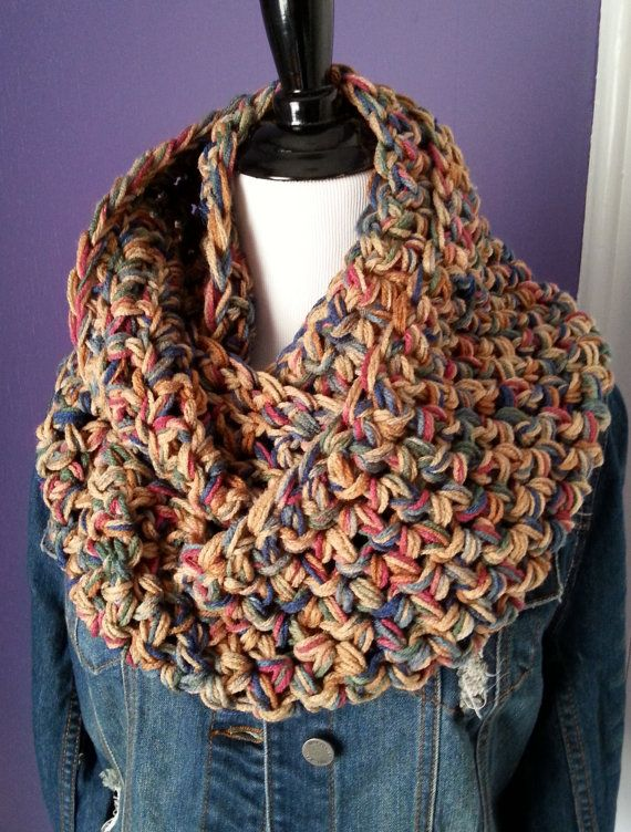"""This super chunky infinity scarf was hand crocheted using a triple strand of worsted weight acrylic yarn. The standard size for this scarf is 60"""" long (30"""" diameter) x 7"""" wide, but other sizes are available (see variations). Depending on the size you choose, this scarf can wrap 2-3 times around your neck and it is very comfortable, squishy and warm. I use a big hook to make these, which produces really cool looking jumbo stitches. The pictured color is called """"Painted Desert"""", a mix of…"""