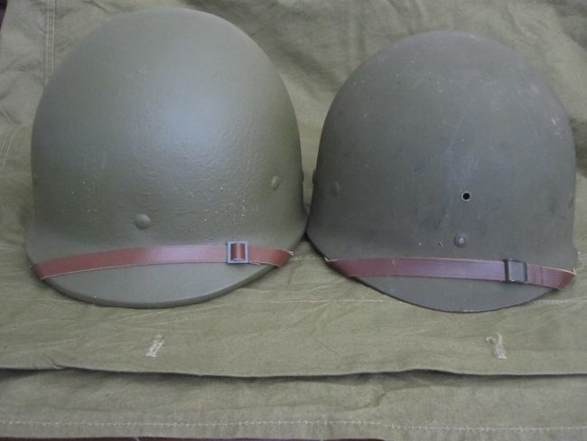 A pair of M1 helmet liners which served the US personnel through the early and closing years of WWII.