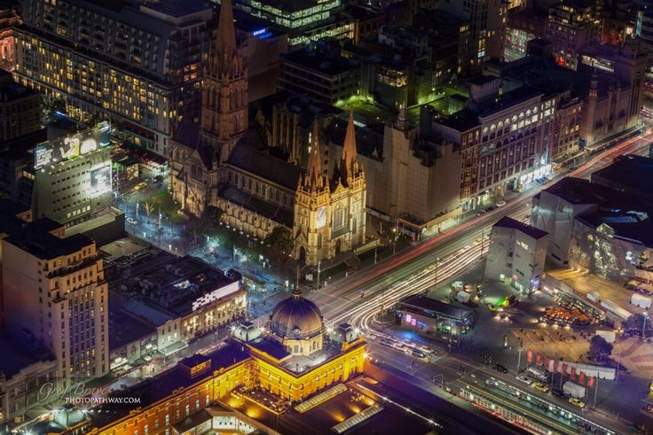 Aerial view of Flinders Street Station and St. Paul's Cathedral at night.