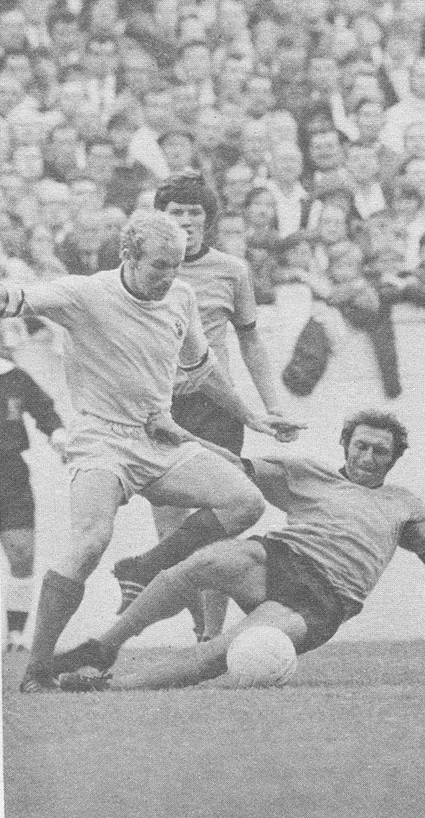 30th August 1969. Coventry City's Dave Clements tackled by Wolves Mike Bailey and watched by Peter Knowles, in one of his final football matches.