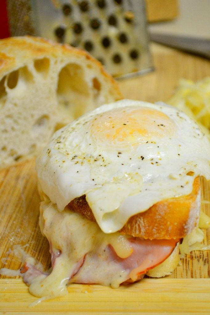 Croque Madame Monsieur traditional french sandwich authentic recipe Slices of boiled ham Bread. I prefer fresh, but you can also use toast bread Yellow cheese of your liking or grated cheese 2 eggs, organic A little butter A little olive oil Salt & freshly ground pepper