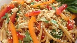 This Asian-inspired pasta salad, made with thick Chinese noodles, is seasoned with toasted sesame seeds and has a tangy sweet-and-sour dressing designed to cool you off on a hot day. Red bell peppers, carrots, and zucchini give it bright colors.