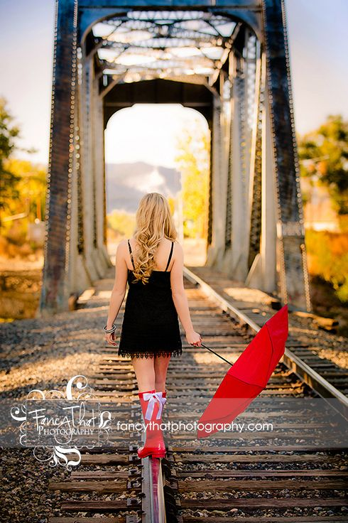 Senior pic ideas Fancy That Photography Gwen Bradbury #fancythatseniors senior girl fun props umbrella rainboots railroad tracks cute dress mountains darling photo senior pics fun pose unique senior photos