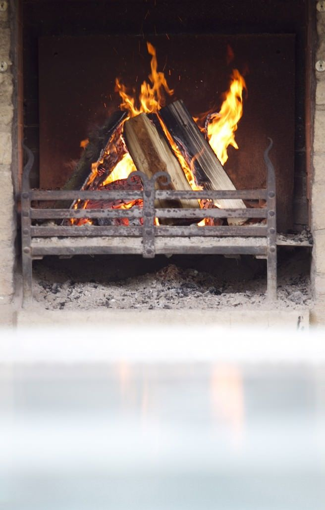 Listen to the crackle of the outdoor log fire as you wallow in Cotswolds hotel Calcot Manor's spa hot tub with a glass of Champagne>  http://www.calcotmanor.co.uk/calcot-spa/