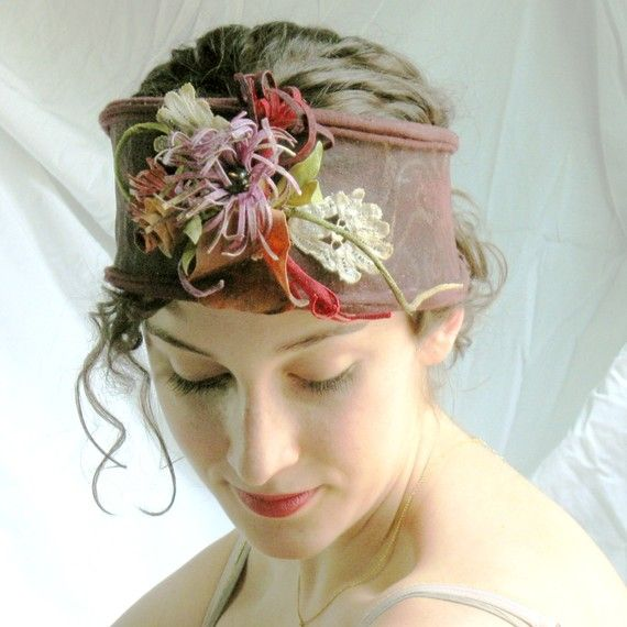 Garden of earthly delights headpiece is made from recycled,refashioned T shirts.Hand painted ,stiffened,cut,hand beaded and fashioned into this exuberant wearable art headpiece.