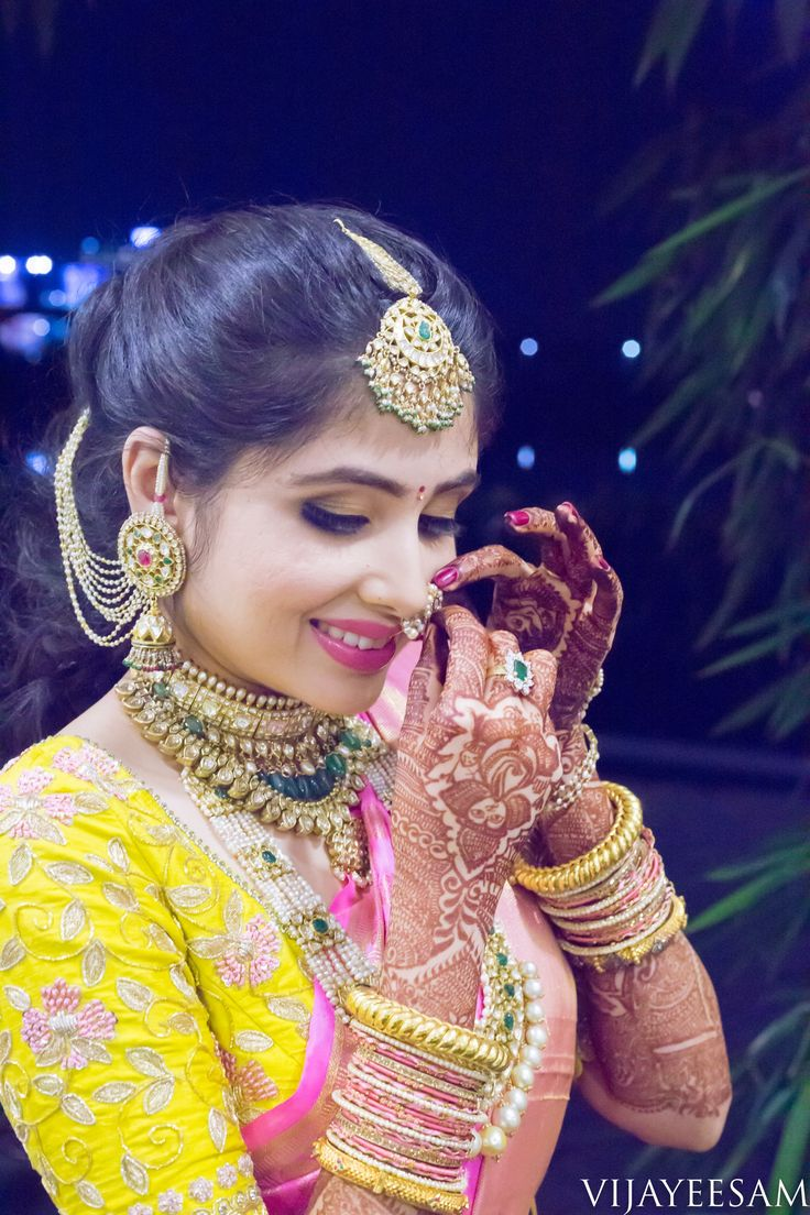A blush pink saree, a mellow yellow blouse and a shy smile! That was all this beautiful bride needed to look absolutely gorgeous on her Engagement. These beautiful images were taken by Vijay Eesam (Vijay Eesam Photography) and the make-up was done by Sohini at Soh Touch MakeUp Artistry - Sohini and they have done an amazing job! The images port...