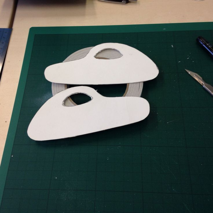 Stencils made out of card to use as templates on blue foam , before using the wire cutting machine .
