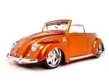 Orange vintage VW Beetle convertible.