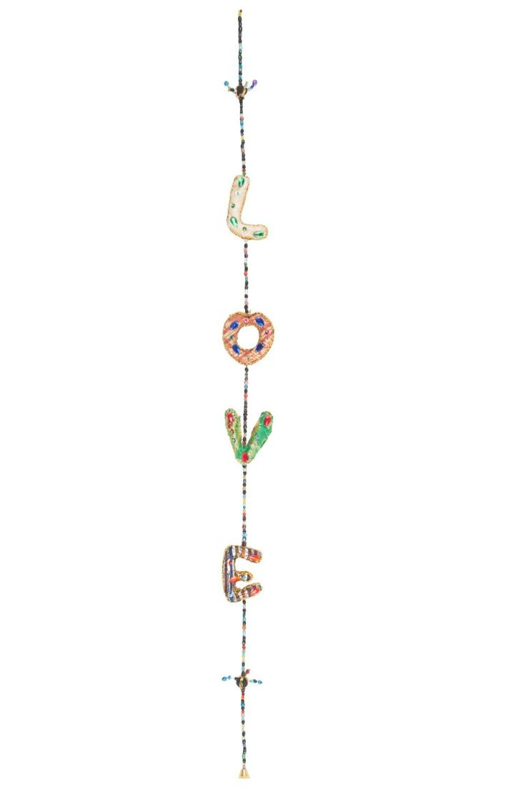 """This """"LOVE"""" string is handmade by women from small villages in Rajasthan India. They are a Fair Trade traditional decoration that is perfect hung near a window or doorway. They also make great gifts for birthdays Christmas and hostesses.  Approx 48 inches in length  Love Hanging String by Chai. Home & Gifts - Home Decor - Decorative Objects Canada"""