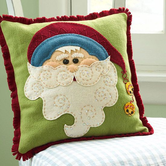Handmade Santa Pillow:  Make this cute Santa Claus pillow as a Christmas gift or a festive accessory for your own holiday decor.  Learn more about this project.  http://www.bhg.com/christmas/crafts/jolly-santa-claus-pillow/