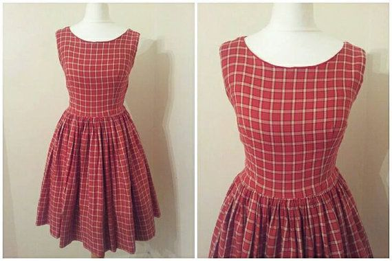 Lovely 1950s tartan dress , metal zip to the side, Red cotton lined to the bodice .A Gorgeous dress for everyday wear ! Material:cotton and wool blend Measurements Bust 30-32 inches  Waist 25 inches  Hips : Free Length 35.5 inches the dress has a 5 inches hem looks like it has been taken up as it has a 6 inch hem , so could be let down    If you love our shop please join us on Facebook and Twitter !!    Facebook - https://www.facebook.com/dottysvintage    Twitter…