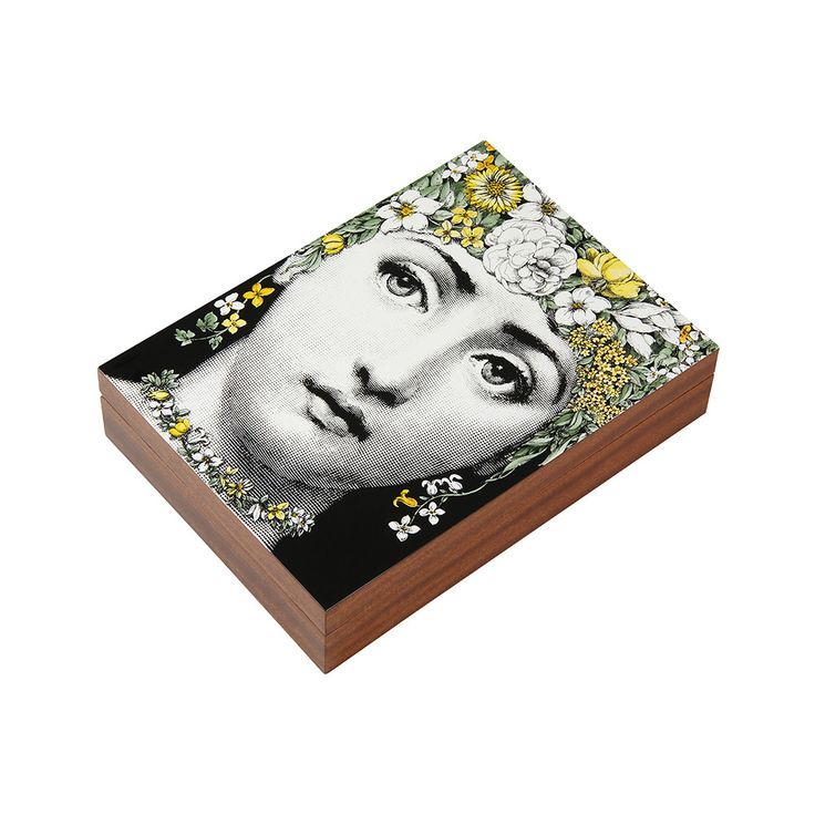 Keep treasured items safe inside this luxurious Flora box from Fornasetti. Made from wood, this lidded box features the stunning face of Lina Cavalieri adorned in colourful flowers. Perfect for storin