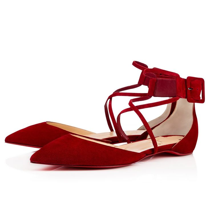 """""""Suzanna Flat"""" pushes the boundaries this season with her striking architecture. In sultry carmin suede, she blends a d'Orsay last with a flattering cross-over ankle strap feature. Her chic cutaway heel and covered buckle put the finishing touch on this singular pointed-toe flat style."""