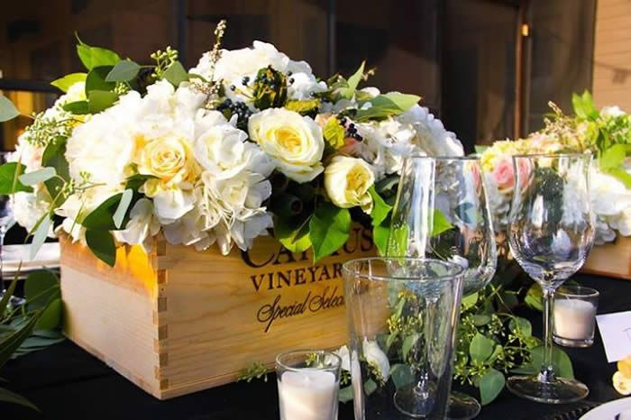 Wine boxes with flowers for decor throughout venue.  On the coffee table in the sitting room and maybe on the fireplaces and outside the front door?