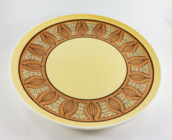 Onion design Round Chop Plate by USA  Plate is done in yellow and Orange with a onion design border.  Plate is 12 1/2 inches in width from side to side.  No chips or cracks but does have some utensil marks