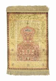 SILK AND METAL-THREAD KOUM KAPI PRAYER RUG SIGNED, ISTANBUL, TURKEY, CIRCA 1920 Of 'Sultan's Head' design, 4ft.3in. x 2ft.11in. (130cm. x 89cm.)